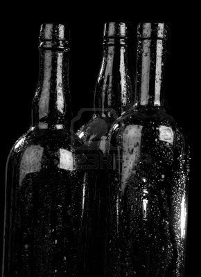 3886383-bottle-and-drops-of-a-condensate-on-a-black-background