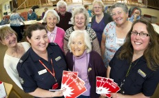 Leigh-Anne Parfitt (front left) and Leanne Shovel with members of the Helston Memory café during a session about fire safety at home and home fire safety checks.